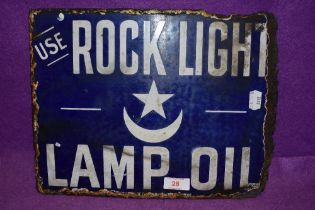 A partial enamel double sided advertising sign for Rock Light Lamp Oil