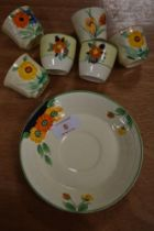 A selection of Clarice Cliff style ceramics hand painted with flowers including siz egg cups and one