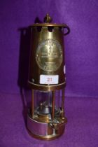 A brass presentation miners lamp by protector lamp and lighting No. 6 Eccles