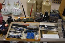 A good selection of desk top items including stationary and ink fountain and ball point pens