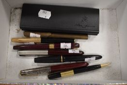A selection of desk top fountain and similar ball point pens including Parker