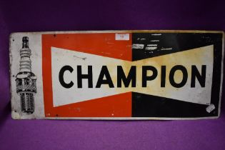 A tin printed garage sign for Champion spark plugs