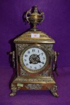 A heavy set continental brass bracket clock having enamel dial chime and extensive ormolu