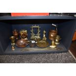 A selection of brass and copper wares including small gong stand and graduated sauce pans
