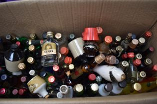 A box of Miniatures including Cossack Vodka, Martel Cognac, Cornish Mead, Lambs Navy Rum etc