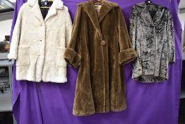 Three vintage faux fur coats.