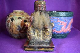 A mixed collection of vintage items including carved oriental figure and ,vase and planter