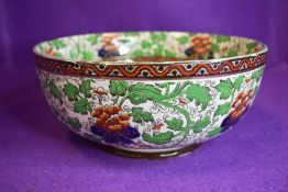 A Royal Doulton fruit bowl having floral transfer pattern with hand tinted details in green,