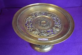 A antique brass tazza or similar having crown and maidens in side profile to top.