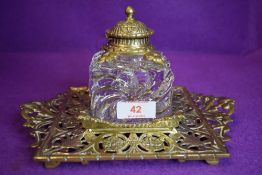 A substantial Townsend & co glass inkwell with intricately detailed tray and lid.