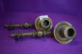 A pair of ornately decorated antique detachable carriage candle sticks