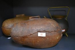 An unusual pair of stoneware hedgehog roasters and a brass and copper kettle.