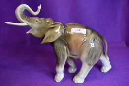 A Royal Dux elephant having pink triangular lozenge to underside.