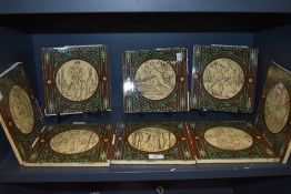 Eight Minton tiles each one depicting a man carrying out a different chore or task, including