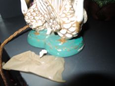 An antique royal Worcester desk top lamp having figural swan decoration to base with gilt