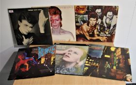 A lot of Seven David Bowie albums with relevant inners - all in good playing condition