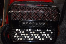 An Ellegaard Special button accordion, with plush lined case, in very clean condition