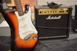 An Encore electric guitar (Fender Stratocaster style) and a Marshall MG15CD practice amplifier