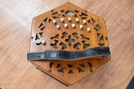 A traditional 21 button concertina, labelled Lachenal, 62872 early 20th Century, in wooden case