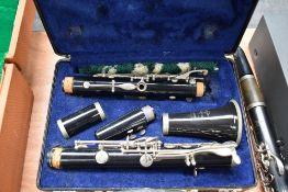 A Bundy (Selmer) resonite clarinet, impressed serial number 1459259, in toughened plastic plush