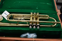 A Chinese brass trumpet, stamped Singha , in velvet lined case