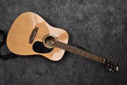 An Encore EA255 Electro Acoustic guitar, serial number 2104102957, with Ritter padded gig bag