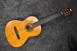 A vintage Marlin spanish style acoustic guitar