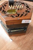 A traditional 48 button concertina, probably Lachenal late 19th/early 20th Century, some splitting