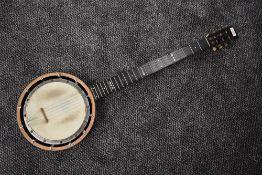 An early 20th Century 5 string Banjo, impressed mark W E TEMLETT, LONDON, Apollo Model number three,