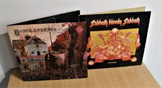 A lot of two Black Sabbath albums , the debut is a later spaceship label press and Sabbath Bloody