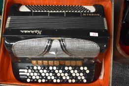 A vintage Hohner Riviera IV button accordion, in vintage lined card case