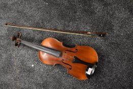 A French Violin, labelled Louis Cherpitel, having two piece 14in (36cm) back, in hard case with
