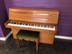A vintage upright piano, labelled Duck Son & Pinker Ltd and Mahler