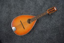 A vintage sunburst flat back (slight bowl) mandolin , not labelled, with soft bag