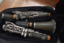 A Paris Debut clarinet, impressed serial number K3127, in back pack style case