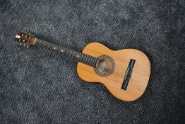 A vintage Encore by John Hornby Skewes student guitar, model ENC36N, soft case and couple of music