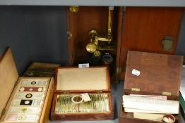 A fine selection of antique scientific microscopes and labeled slide sets natural history related