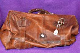 A vintage leather duffel or sports bag bearing label Topeu