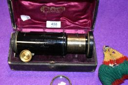 An antique cased brass bodied lens Extension No. 103525 Tele Objectif Panorthoscopeique in great