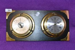 A ships style porthole clock and barometer set
