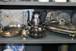 A selection of plated wares including serving mats and lidded glass lined serving dish