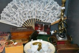 A selection of curios and decorations including brass twist stem lamp base Ilford camera and trinket