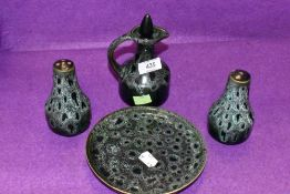 A ceramic sauce or cruet set with green glaze