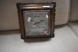 A mid 20th Century barometer in square oak case