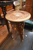 An Eastern carved occasional table