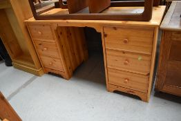 A vintage pine dressing table or desk