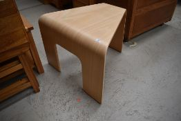 A vintage bent ply occasional table or stool of triangular form in the style of Bloom, max width