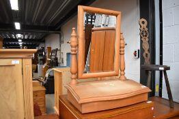 A natural pine toilet mirror having storage base