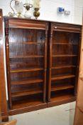 A pair of oriental hardwood open bookshelves, having concealed upper drawer