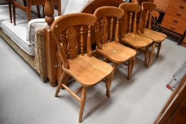 A set of four solid seat golden oak traditional style kitchen chairs, stamped 1998